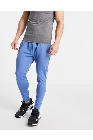 ASOS Icon super skinny training joggers with quick dry in blue