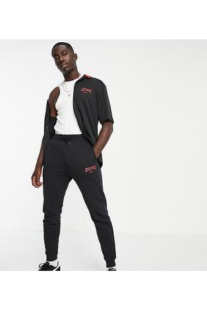 Reebok Vintage logo joggers in black - exclusive to ASOS