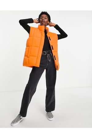 ASOS Gilet puffer jacket in orange