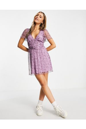 ASOS Mulher Vestidos Casual - Mesh ruched front mini dress in purple floral