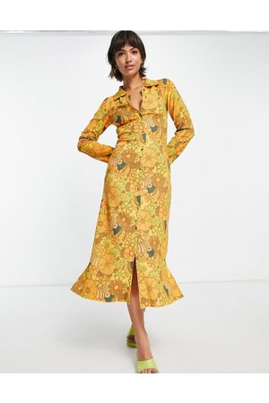 Damson Madder Recycled polyester 70's floral button through midi dress in warm yellow