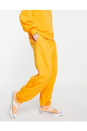 ASOS Co-ord super oversized joggers with pocket in bright orange