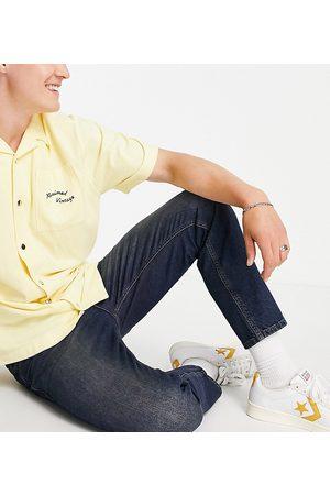 Reclaimed Homem Slim - Inspired slim tapered jean in dark blue wash