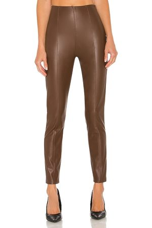Free People Spitfire Stacked Skinny Legging in - Brown. Size 24 (also in 25, 26, 27, 28, 29, 30, 31).