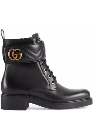 Gucci Mulher Botins - Logo-plaque ankle boots
