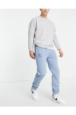 New Era Homem Joggers - New York Yankees relaxed fit joggers in soft blue