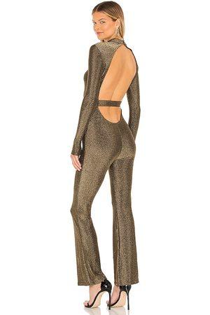 superdown Nissa Open Back Jumpsuit in - Gold. Size L (also in XXS, XS, S, M, XL).