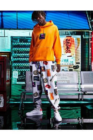 ASOS Homem Joggers - Co-ord balloon joggers in white with all over photographic prints