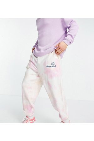 ASOS ASOS Daysocial co-ord relaxed tie dye jogger with logo print in pink and orange