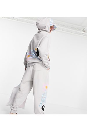 ASOS Homem Joggers - ASOS Daysocial co-ord oversized jogger with multi placement logo and graphic prints in stone-Neutral