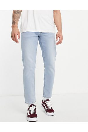 ASOS Stretch tapered jeans in light wash-Blue