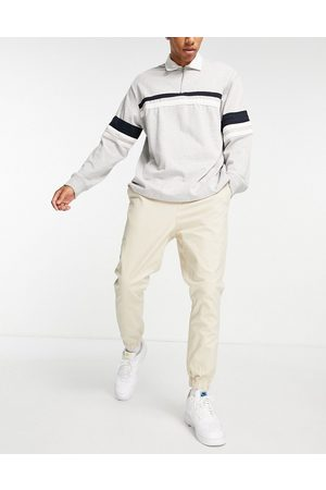 ASOS Tapered chino joggers with elasticated waist in beige-Neutral