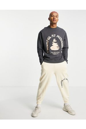 ASOS Oversized tracksuit in mismatch colours with wellness prints-Multi