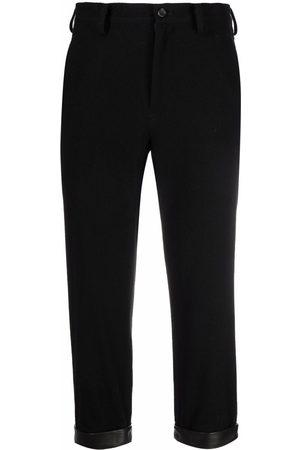 YOHJI YAMAMOTO Mulher Calças em Pele - Cropped leather-cuff trousers
