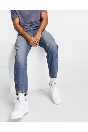 Topman Homem Tapered - Curved leg taper jeans in mid wash-Blue