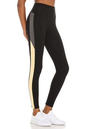 Yummie by Heather Thomson Rachel Legging With Two Color Racing Stripe in Black Smoke & Lemon Drop - Black. Size L (also in M, S, XS).