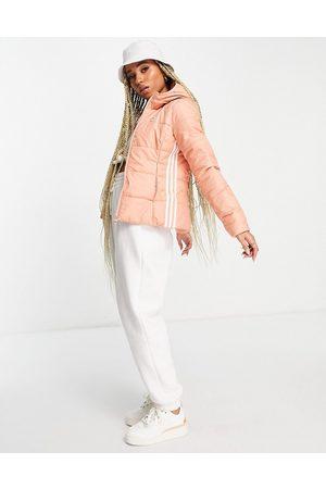 adidas Three stripe slim fit padded jacket in blush-Neutral