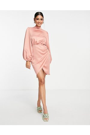 Flounce London Satin wrap front mini dress with high neck in blush pink