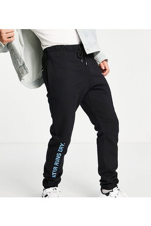 9N1M SENSE Homem Joggers - Exclusive to ASOS co-ord joggers in black with cold as ice print