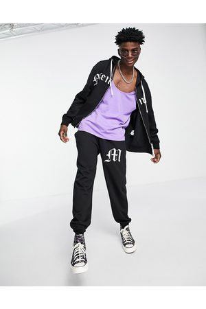 Mennace Homem Joggers - Co-ord joggers in black with gothic applique