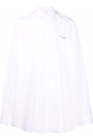 Raf Simons Homem Casual - Synchronicity logo-embroidered oversized shirt