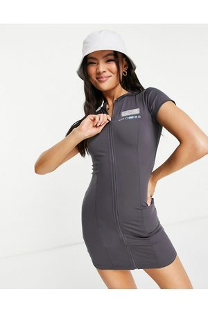 The Couture Club Fitted zip through mini dress in charcoal-Grey
