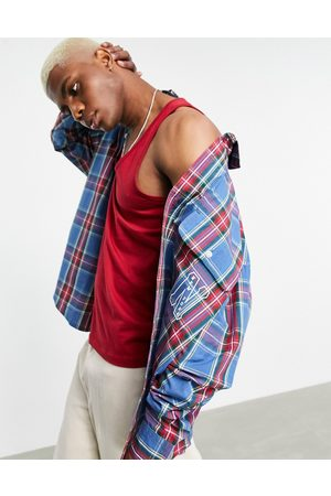 ASOS Extreme oversized long sleeve shirt in collegiate check with city embroidery-Blue