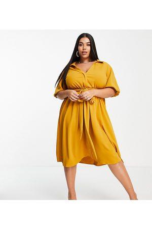 ASOS ASOS DESIGN Curve wrap shirt midi skater dress with self belt in mustard-Orange