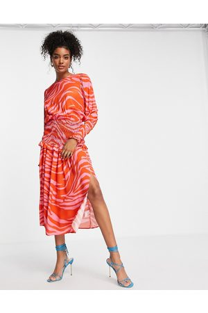 Never Fully Dressed Shirred waist midi tea dress in red and pink zebra