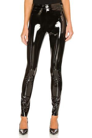 ALICE+OLIVIA Maddox Back Zip Vegan Leather Legging in - . Size 0 (also in 2, 4, 6, 8, 10).