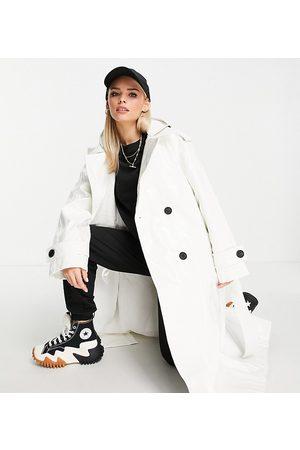 ASOS ASOS DESIGN Petite glossy patent hooded trench coat in cream-White