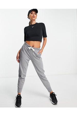 Nike Mulher Joggers - Dri-FIT logo joggers in grey
