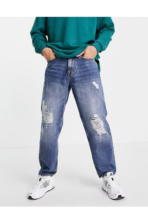 New Look Homem Slim - Baggy 90s fit jeans with rips in blue wash