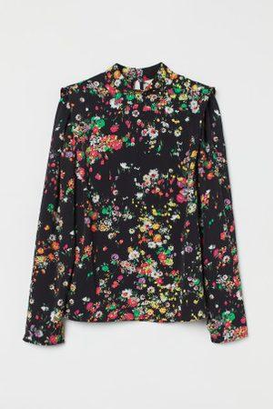 H&M Blusa de ombros definidos