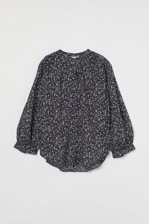 H&M Blusa em algodão