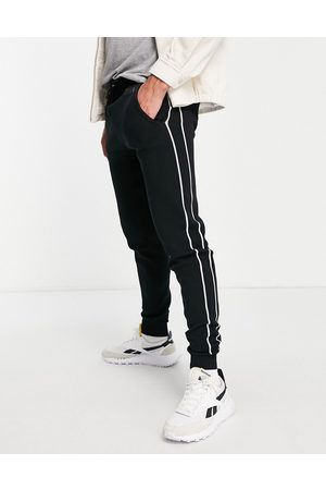 River Island Homem Joggers - Co-ord knitted joggers in black