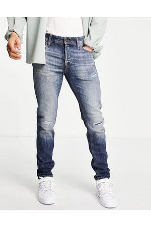 jack & jones Homem Slim - Intelligence Glenn slim fit super stretch jeans in washed blue with knee rips