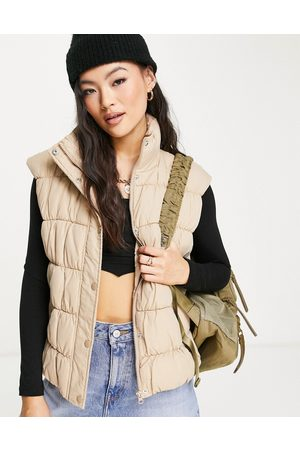 NA-KD X Anna Briand ruched detail padded gilet in beige-Neutral